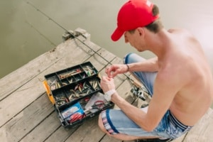 Fisherman and tackle box