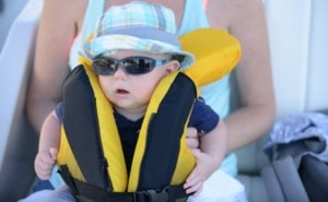 Baby wearing life jacket