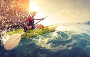 Woman in an ocean kayak
