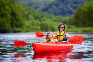 Mother and child in a tandem kayak