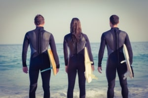 Group of friends in wetsuits